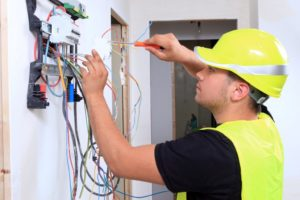 An electrician rewiring a home in Peachtree City